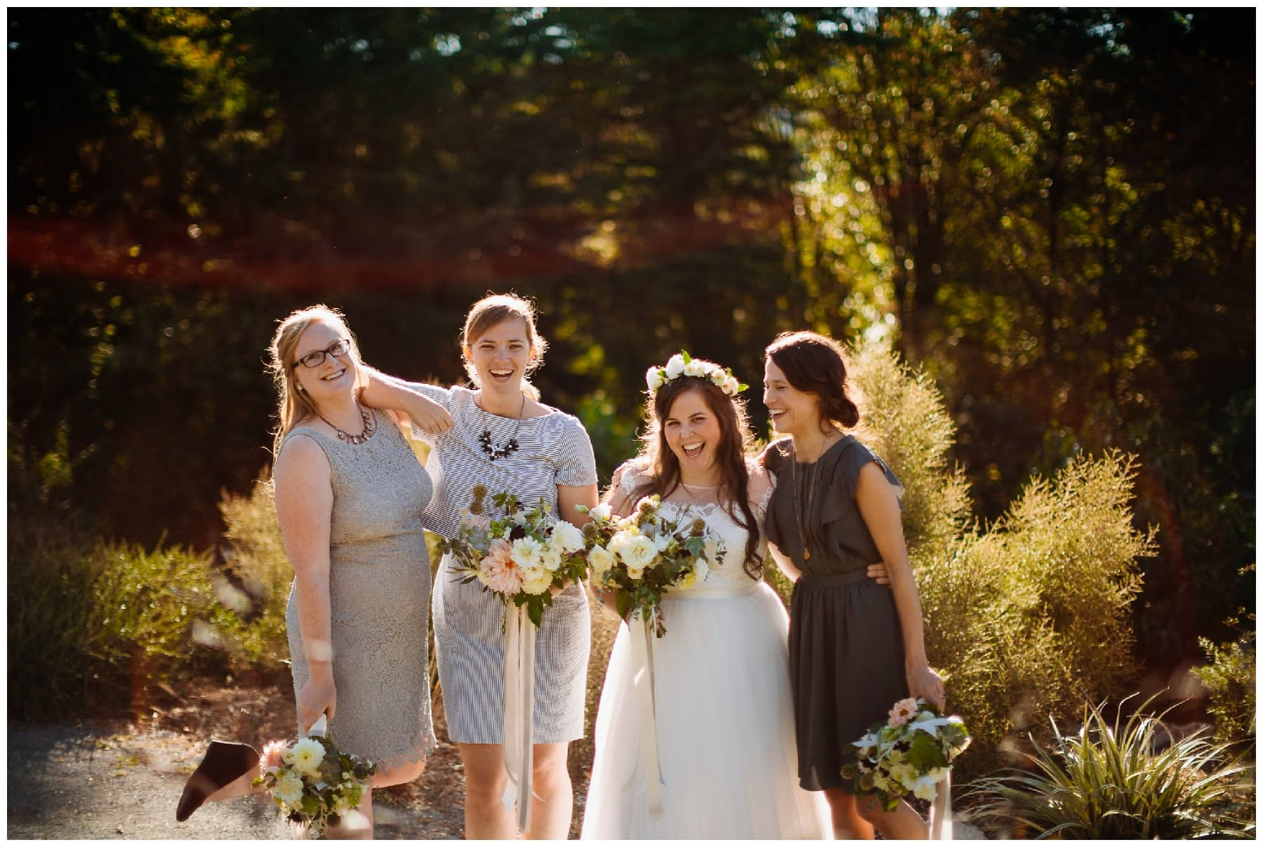 bridesmaids pose in the sunset