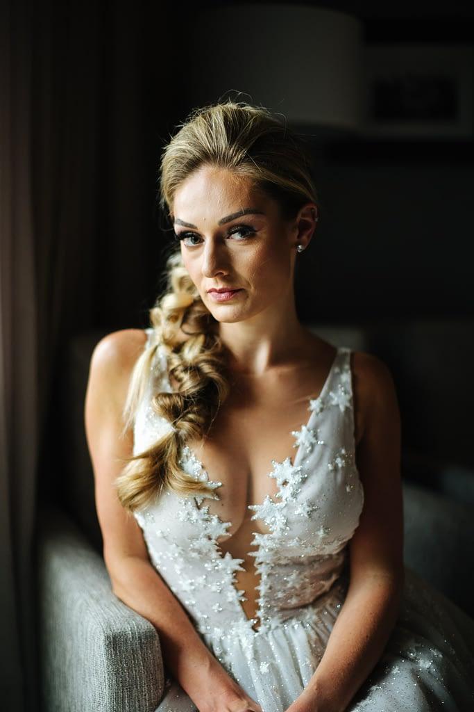 Bride with star dress sits by window Salish Lodge wedding
