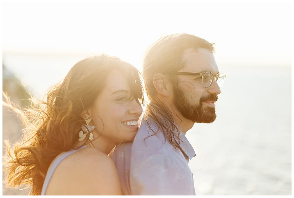 couple watches sunset on Washington State Ferries engagement photos
