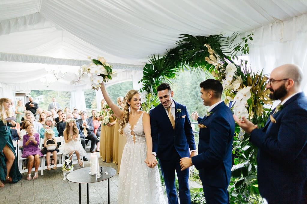 Bride and groom celebrate after being married Salish Lodge weddi