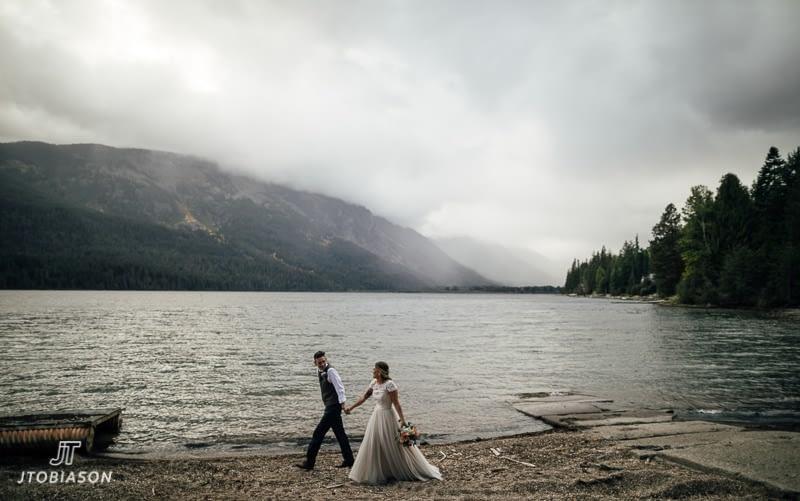 bride and groom walk along beach brown family homestead wedding