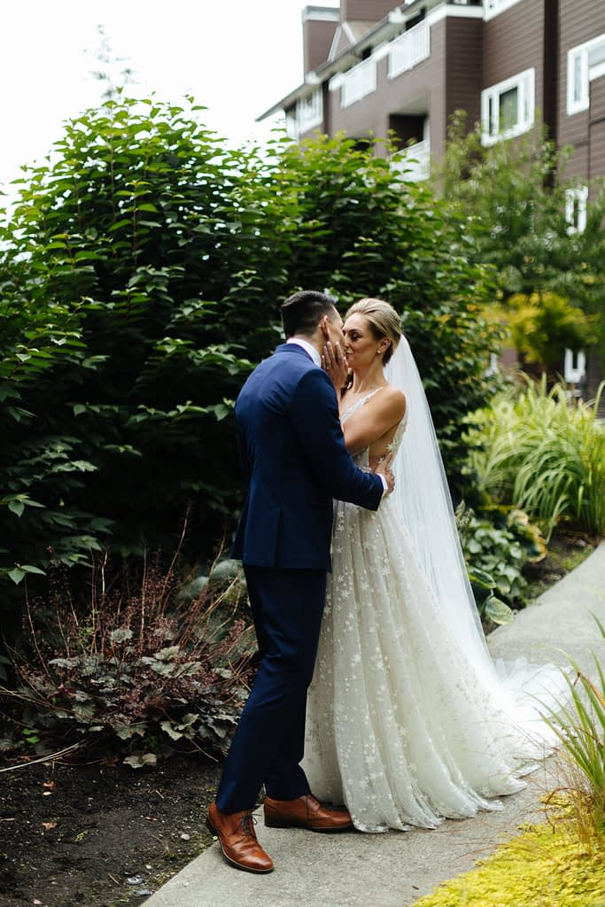 Bride and groom kiss during first look Salish Lodge wedding