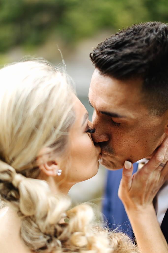 bride and groom kiss at Snoqualmie Falls Salish Lodge wedding