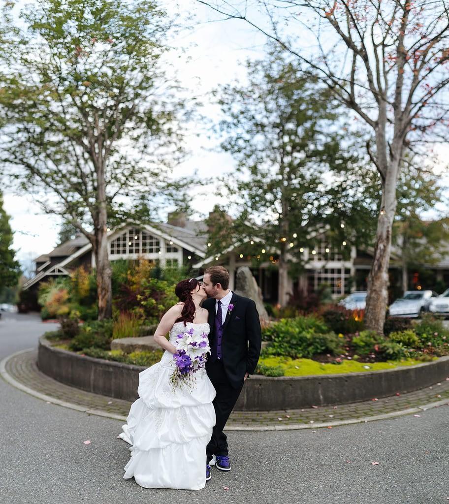 bride and groom kiss outside Salish Lodge wedding venue