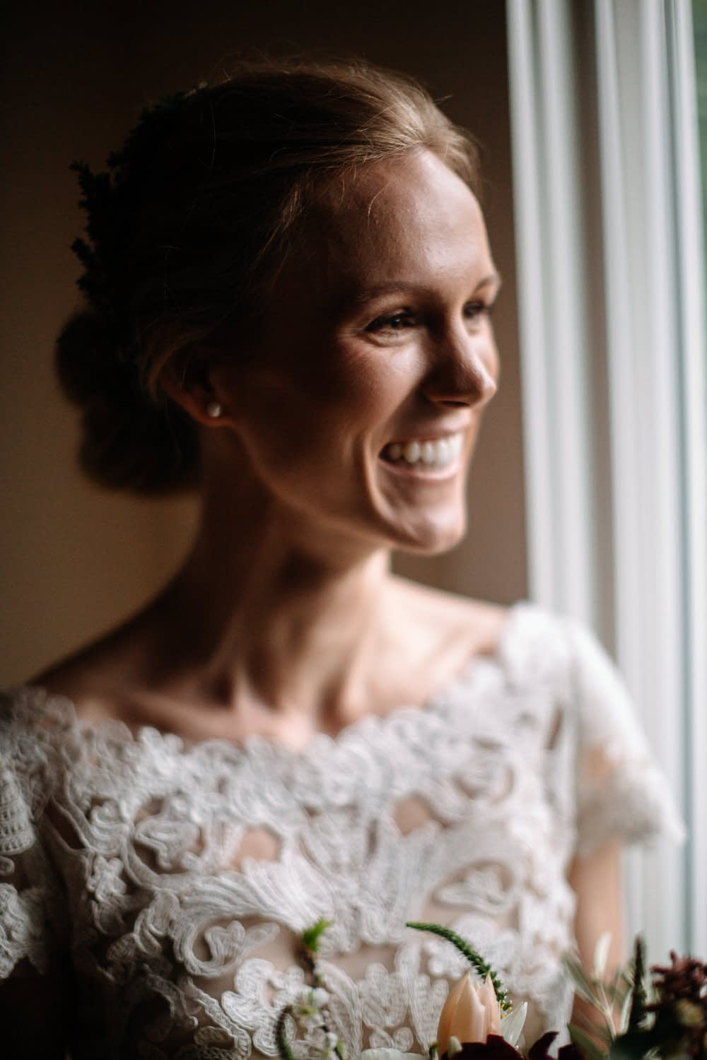 Bride smiles out window Seattle Courthouse Elopement photo