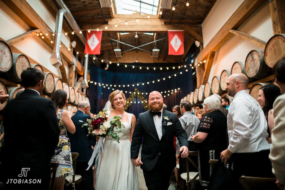 Bride and groom walk Westland Distillery Wedding