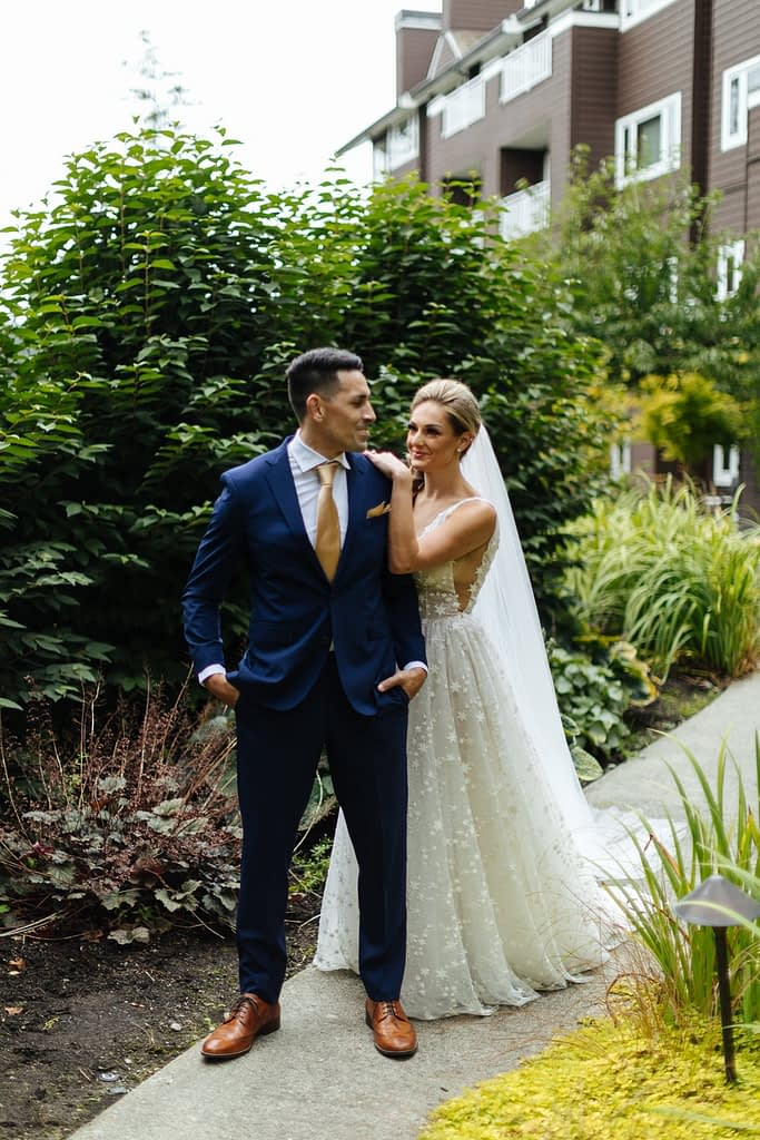 bride smiles at groom during first look Salish Lodge wedding