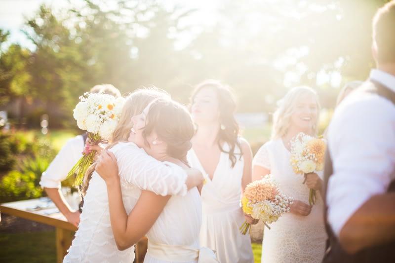 bride hugging friend backyard wedding