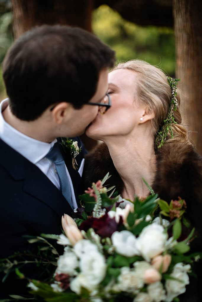 bride and groom kiss downtown seattle elopement