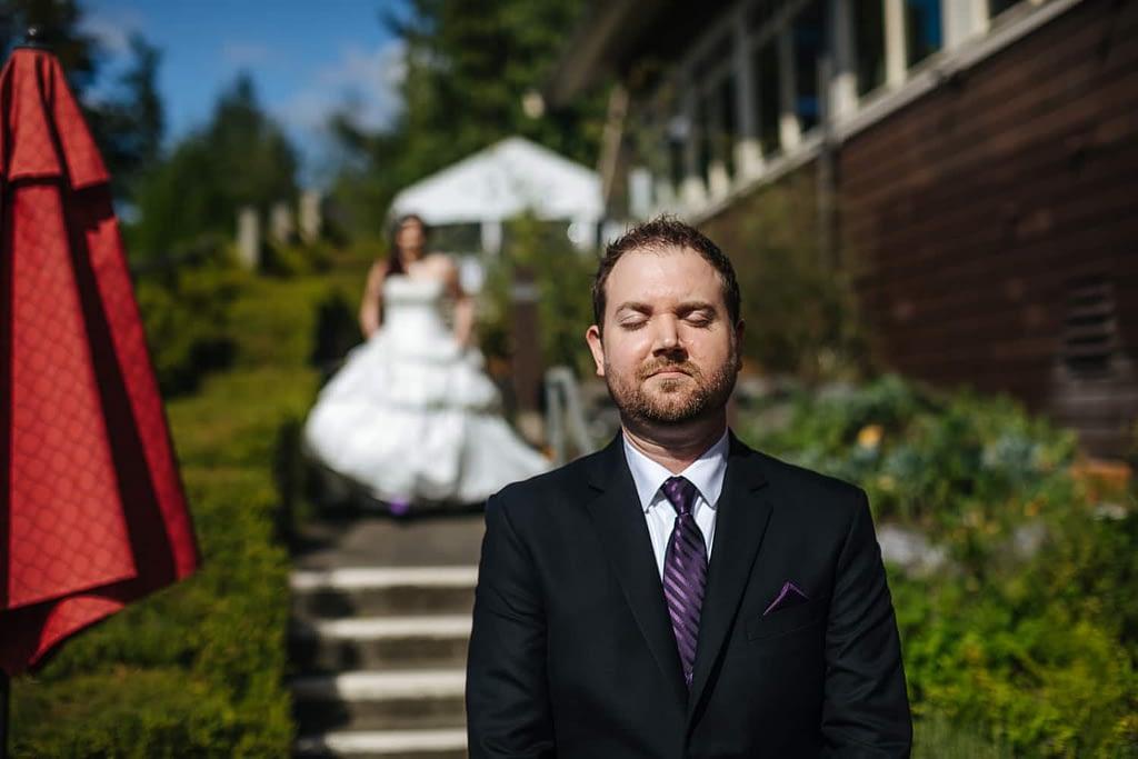 Groom waits for first look Salish Lodge wedding venue