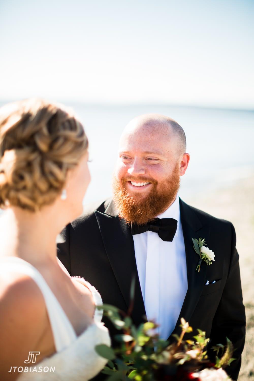 Gromo smiles at bride Discovery Park Wedding
