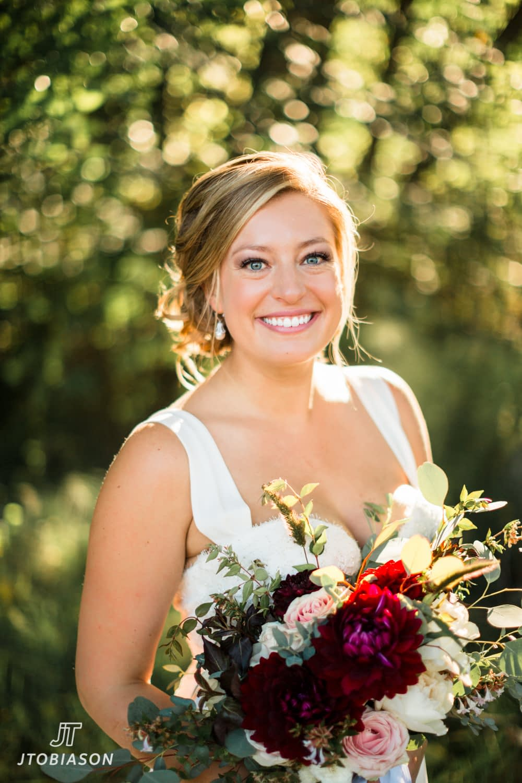 Bride smiles at camera Discovery Park WEdding