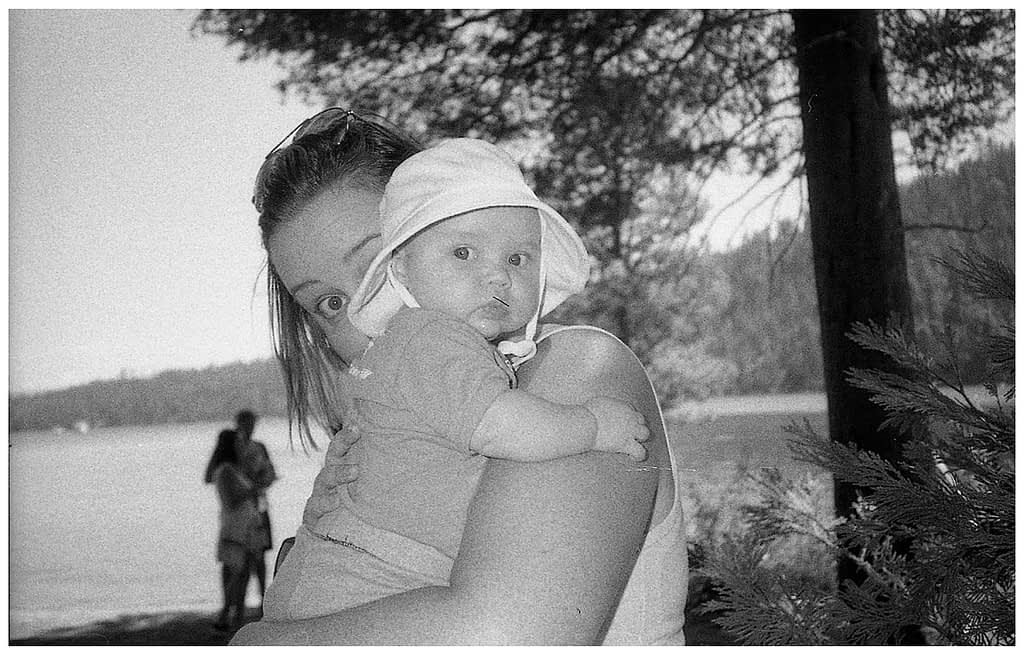 black and white film photo of baby