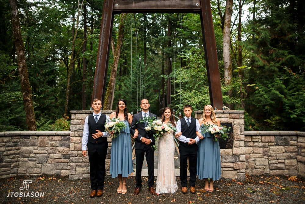 Wedding party stands by bridge bellevue botanical gardens wedding