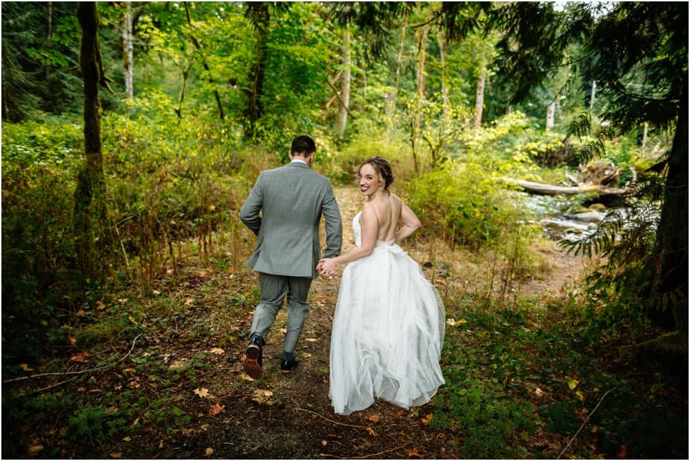 bride and groom run Preston Community Center wedding