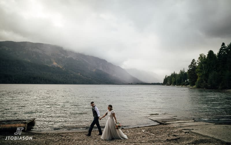 bride and groom walk along beach brown family homestead wedding
