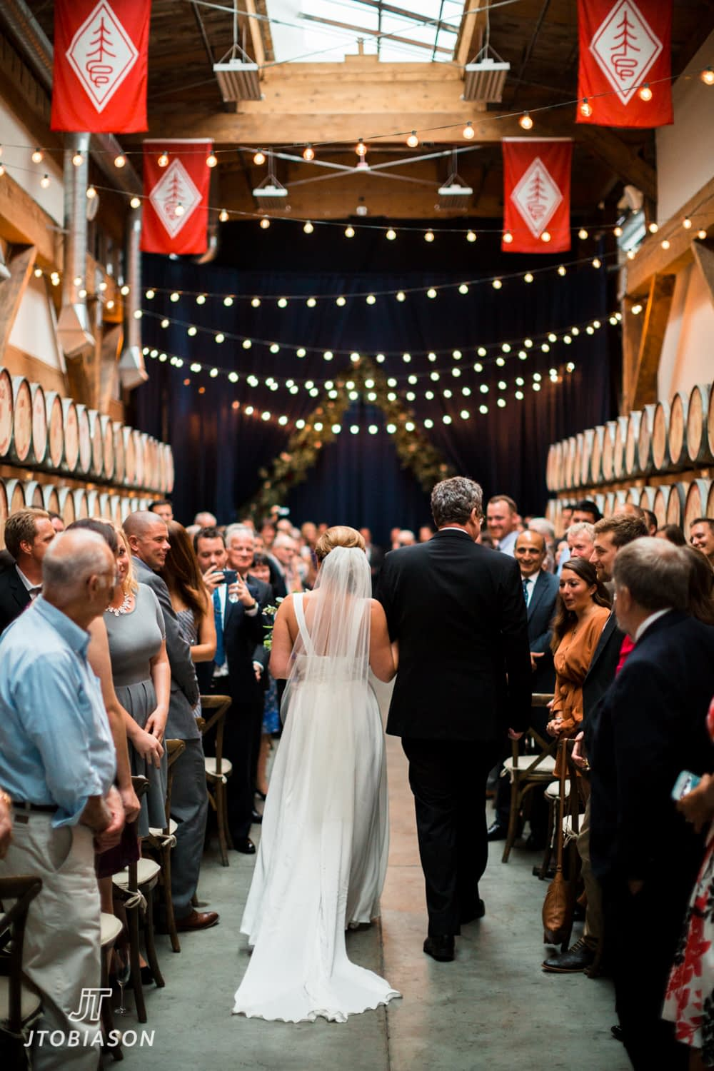 Bride and father walk down aisle Westland Distillery Wedding