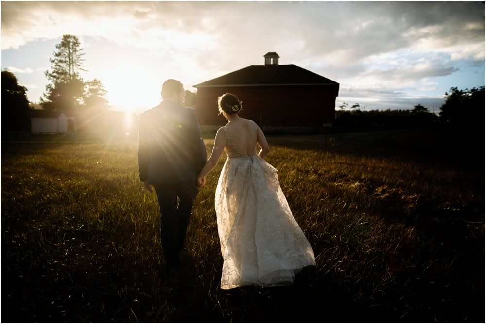 bride and groom walk in the sunset