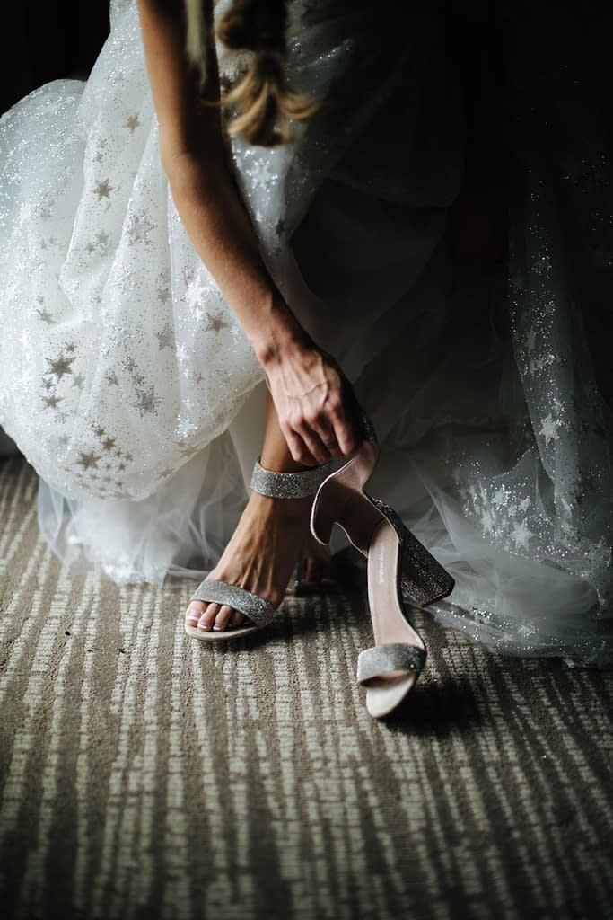 bride in star dress puts on shoes Salish Lodge wedding