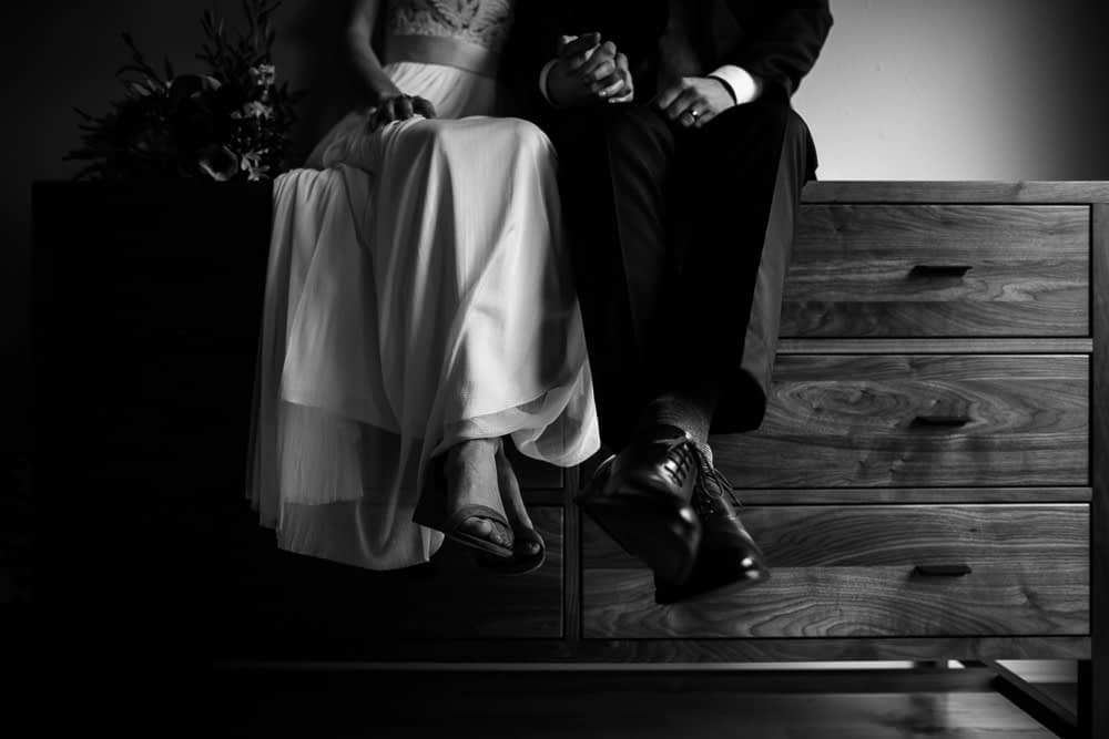 couple sits on dresser Seattle Courthouse Elopement photo