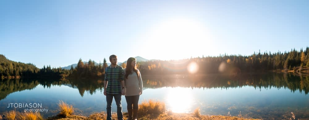 man and woman in sunset panorama snoqualmie pass engagement