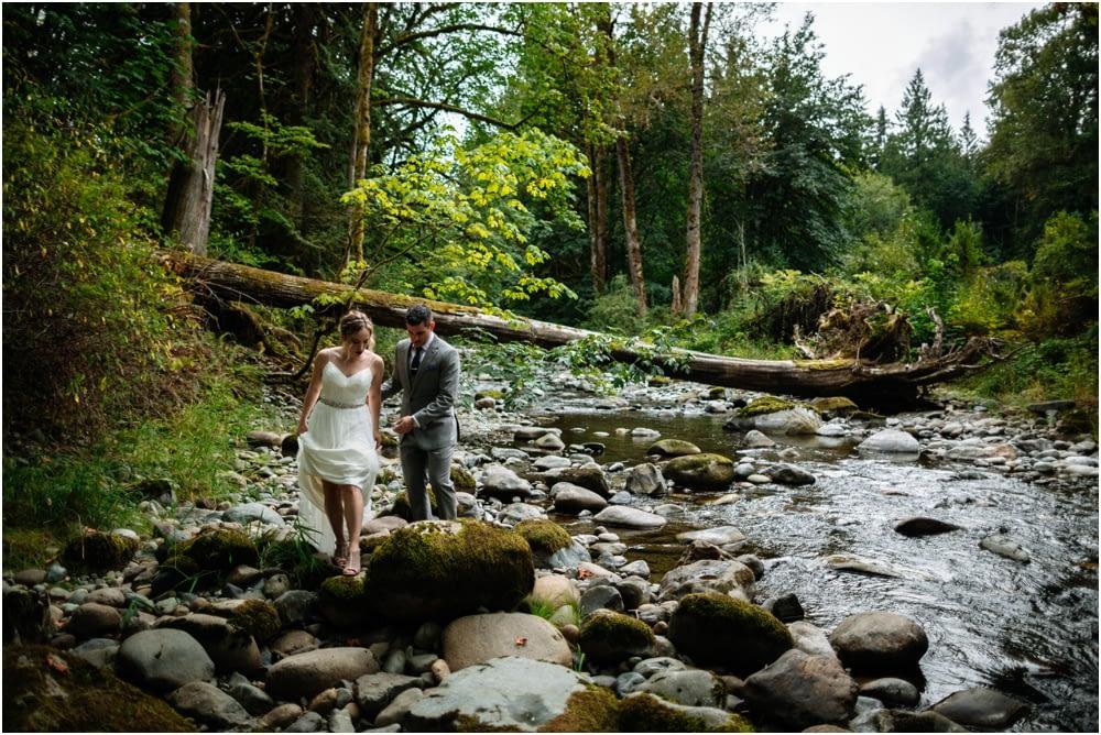bride and groom walk along river Preston Community Center wedding