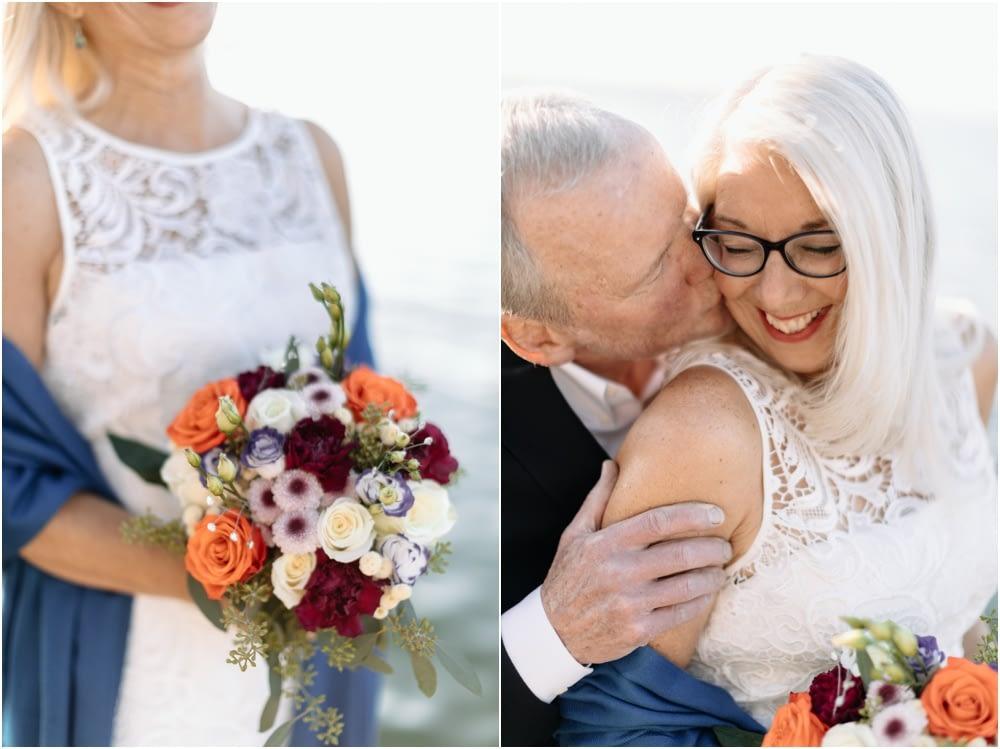 groom kisses bride Hyatt Regency Lake Washington