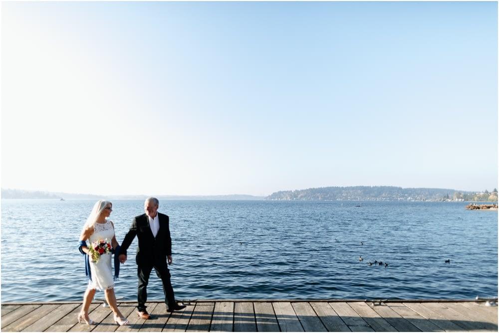 couple walks along water Hyatt Regency Lake Washington