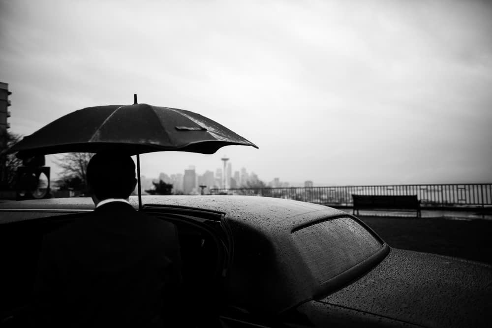 rain on umbrella looking at seattle in black and white