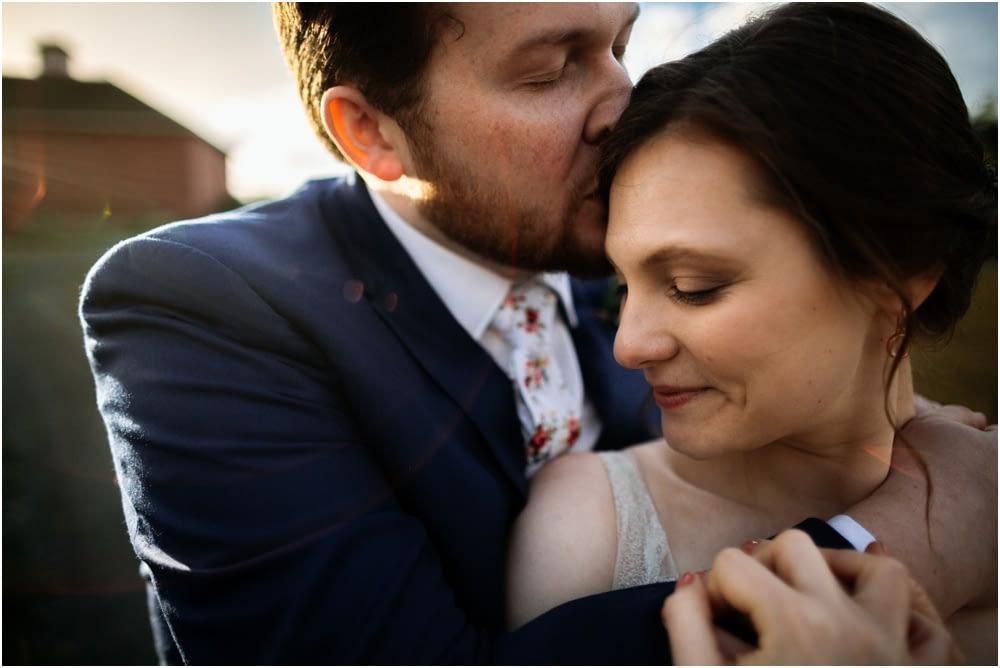 groom kisses bride Crockett Farm Wedding