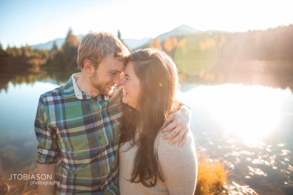 Man and woman laugh in the sunset snoqualmie pass engagement