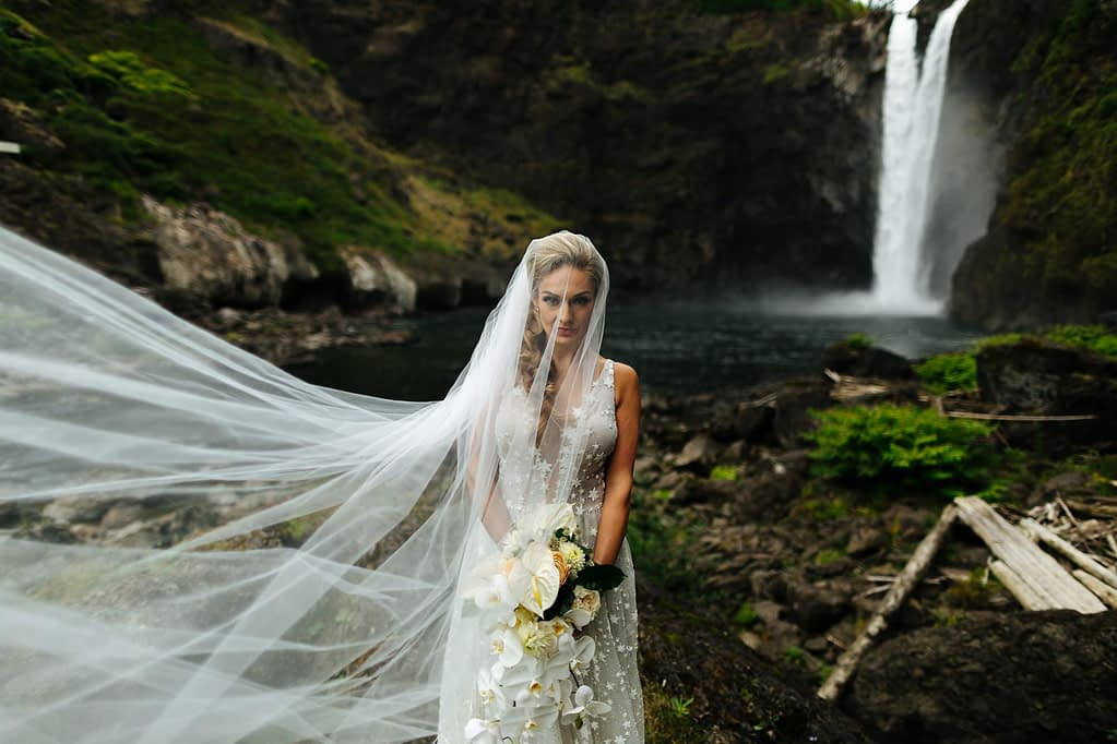 Bride and her veil by snoqualmie falls Salish Lodge wedding